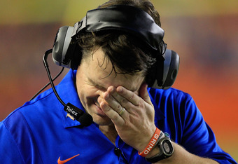 GAINESVILLE, FL - SEPTEMBER 10:  Head coach Will Muschamp of the Florida Gators wipes his face during a game against the UAB Blazers  at Ben Hill Griffin Stadium on September 10, 2011 in Gainesville, Florida.  (Photo by Sam Greenwood/Getty Images)