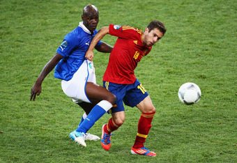 KIEV, UKRAINE - JULY 01:  (L-R) Mario Balotelli of Italy and Jordi Alba of Spain challenge for the ball during the UEFA EURO 2012 final match between Spain and Italy at the Olympic Stadium on July 1, 2012 in Kiev, Ukraine.  (Photo by Martin Rose/Getty Ima