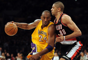 LOS ANGELES, CA - FEBRUARY 20:  Kobe Bryant #24 of the Los Angeles Lakers drives to the basket on Nicolas Batum #88 of the Portland Trail Blazers during the game at Staples Center on February 20, 2012 in Los Angeles, California.  NOTE TO USER: User expres
