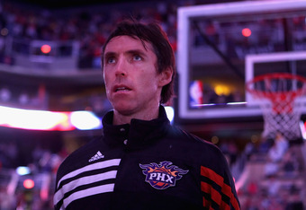 PHOENIX, AZ - APRIL 25:  Steve Nash #13 of the Phoenix Suns stands attended for the National Anthem before the NBA game against the San Antonio Spurs at US Airways Center on April 25, 2012 in Phoenix, Arizona.  The Spurs defeated the Suns 110-106.  NOTE T