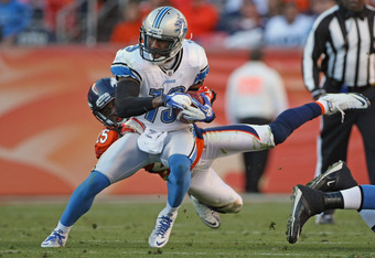 DENVER, CO - OCTOBER 30:  Wide receiver Nate Burleson #13 of the Detroit Lions makes a reception and breaks the tackle of Chris Harris #25 of the Denver Broncos at Sports Authority at Invesco Field at Mile High on October 30, 2011 in Denver, Colorado. The