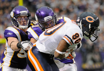 MINNEAPOLIS, MN - JANUARY 1: Chad Greenway #52 and Asher Allen #21 of the Minnesota Vikings look to tackle Earl Bennett #80 of the Chicago Bears during the fourth quarter on January 1, 2012 at Mall of America Field at the Hubert H. Humphrey Metrodome in M