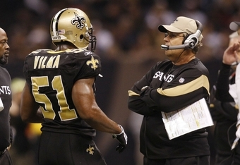 NEW ORLEANS - DECEMBER 19:  Jonathan Vilma #51 of the New Orleans Saints talks with defensive coordinator Gregg Williams in the first quarter against the Dallas Cowboys at Louisiana Superdome on December 19, 2009 in New Orleans, Louisiana.  (Photo by Chri