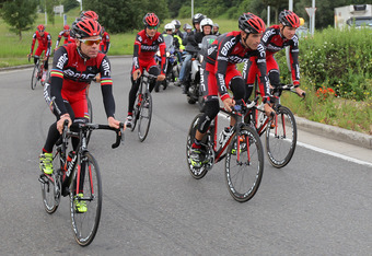 LIEGE, BELGIUM - JUNE 29:  (L-R) Defending champion Cadel Evans of Australia, George Hincapie of the USA and Tejay Van Garderen of the USA lead the BMC Racing Team on a training ride in preparation for the 2012 Tour de France on June 29, 2012 in Liege, Be