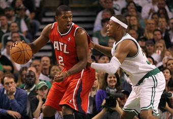 BOSTON, MA - MAY 04:  Joe Johnson #2 of the Atlanta Hawks works his way to the basket against Paul Pierce #34 of the Boston Celtics in Game Three of the Eastern Conference Quarterfinals during the 2012 NBA Playoffs on May 4, 2012 at TD Garden in Boston, M