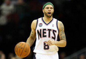 NEWARK, NJ - APRIL 10:  Deron Williams #8 of the New Jersey Nets brings the ball up court in the second half against the Philadelphia 76ers at Prudential Center on April 10, 2012 in Newark, New Jersey.  NOTE TO USER: User expressly acknowledges and agrees