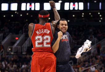 PHOENIX, AZ - JANUARY 13:  Anthony Morrow #22 and Jordan Farmar #2 of the New Jersey Nets celebrate after scoring against the Phoenix Suns during the NBA game at US Airways Center on January 13, 2012 in Phoenix, Arizona. The Nets defeated the Suns 110-103