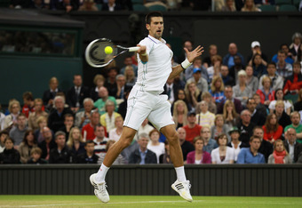 LONDON, ENGLAND - JULY 02:  Novak Djokovic of Serbia returns a shot during his Gentlemen's Singles fourth round match against Viktor Troicki of Serbia on day seven of the Wimbledon Lawn Tennis Championships at the All England Lawn Tennis and Croquet Club