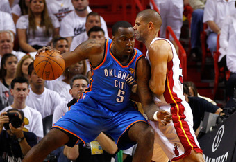 MIAMI, FL - JUNE 19:  Kendrick Perkins #5 of the Oklahoma City Thunder posts up in the first quarter against Shane Battier #31 of the Miami Heat in Game Four of the 2012 NBA Finals on June 19, 2012 at American Airlines Arena in Miami, Florida. NOTE TO USE