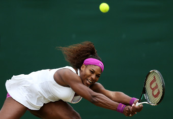 LONDON, ENGLAND - JULY 02:  Serena Williams of USA hits a backhand return during her Ladies' singles fourth round match against Yaroslava Shvedova of Kazakhstan on day seven of the Wimbledon Lawn Tennis Championships at the All England Lawn Tennis and Cro