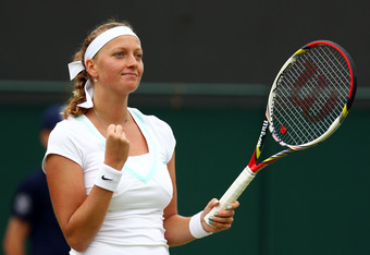 LONDON, ENGLAND - JULY 02:  Petra Kvitova of Czech Republic celebrates after her Ladies' singles fourth round match against Francesca Schiavone of Italy on day seven of the Wimbledon Lawn Tennis Championships at the All England Lawn Tennis and Croquet Clu
