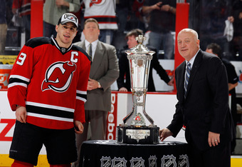 NEWARK, NJ - MAY 25:  Zach Parise #9 of the New Jersey Devils is presented with the Prince of Wales Trophy by NHL Deputy Commissioner Bill Daly after in Game Six of the Eastern Conference Final during the 2012 NHL Stanley Cup Playoffs against the New York