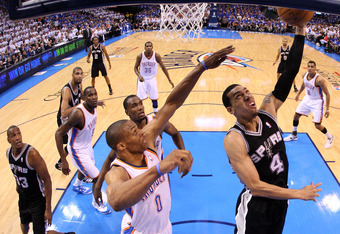 OKLAHOMA CITY, OK - JUNE 02:  Danny Green #4 of the San Antonio Spurs goes up for a layup against Russell Westbrook #0 of the Oklahoma City Thunder in the first half in Game Four of the Western Conference Finals of the 2012 NBA Playoffs at Chesapeake Ener