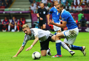 WARSAW, POLAND - JUNE 28:  Marco Reus of Germany battles for the ball with Giorgio Chiellini of Italy during the UEFA EURO 2012 semi final match between Germany and Italy at National Stadium on June 28, 2012 in Warsaw, Poland.  (Photo by Alex Grimm/Getty