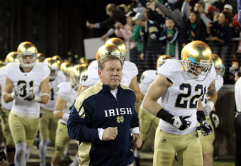 STANFORD, CA - NOVEMBER 26:  Notre Dame Fighting Irish head coach Brian Kelly run on to the field for their game against the Stanford Cardinal at Stanford Stadium on November 26, 2011 in Stanford, California.  (Photo by Ezra Shaw/Getty Images)