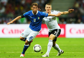 WARSAW, POLAND - JUNE 28: Claudio Marchisio of Italy (L) and Bastian Schweinsteiger of Germany battle for the ball during the UEFA EURO 2012 semi final match between Germany and Italy at the National Stadium on June 28, 2012 in Warsaw, Poland.  (Photo by