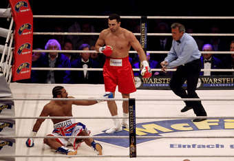 HAMBURG, GERMANY - JULY 02:  Wladimir Klitschko of the Ukraine pushed David Haye of England to the floor during their heavy weight unification match at the Imtech Arena on July 2, 2011 in Hamburg, Germany.  (Photo by Scott Heavey/Getty Images)