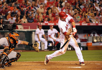 ANAHEIM, CA - JUNE 19:  Mike Trout #27 of the Los Angeles Angels of Anaheim hits a single in the fourth inning against the San Francisco Giants at Angel Stadium of Anaheim on June 19, 2012 in Anaheim, California.  (Photo by Lisa Blumenfeld/Getty Images)