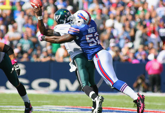 ORCHARD PARK, NY - OCTOBER 09:  Arthur Moats #52 of the Buffalo Bills hits Michael Vick #7 of the Philadelphia Eagles causing Vick to throw an interception in the first half  at Ralph Wilson Stadium on October 9, 2011 in Orchard Park, New York.  (Photo by