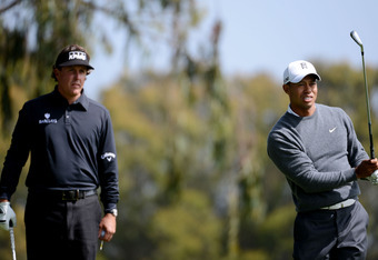 SAN FRANCISCO, CA - JUNE 14:  Tiger Woods of the United States watches a shot on the second hole as Phil Mickelson looks on during the first round of the 112th U.S. Open at The Olympic Club on June 14, 2012 in San Francisco, California.  (Photo by Harry H