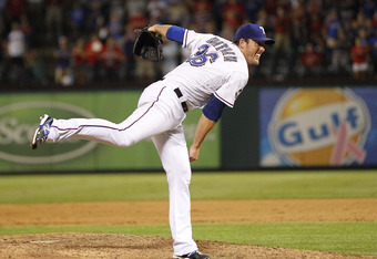 ARLINGTON, TX - JUNE 24: Joe Nathan #36 of the Texas Rangers delivers the last pitch of the ninth inning striking out Jason Giambi #23 of the Colorado Rockies in the interleague game at Rangers Ballpark in Arlington on June 24, 2012 in Arlington, Texas. (