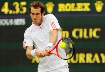 LONDON, ENGLAND - JULY 02:  Andy Murray of Great Britain returns the ball during his Gentlemen's Singles fourth round match against Marin Cilic of Croatia on day seven of the Wimbledon Lawn Tennis Championships at the All England Lawn Tennis and Croquet C