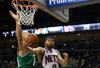 NEWARK, NJ - APRIL 14:  Deron Williams #8 of the New Jersey Nets drives for a shot attempt in the second half against Greg Stiemsma #54 of the Boston Celtics at Prudential Center on April 14, 2012 in Newark, New Jersey. NOTE TO USER: User expressly acknow