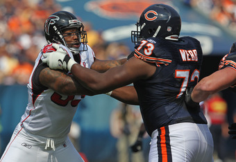 CHICAGO, IL - SEPTEMBER 11:  Ray Edwards #93 of the Atlanta Falcons rushes against J'Marcus Webb #73 of the Chicago Bears at Soldier Field on September 11, 2011 in Chicago, Illinois. The Bears defeated the Falcons 30-12.  (Photo by Jonathan Daniel/Getty I