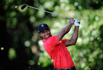 BETHESDA, MD - JULY 01: Tiger Woods tees off on the 14th hole during the Final Round of the AT&T National at Congressional Country Club on July 1, 2012 in Bethesda, Maryland.  (Photo by Rob Carr/Getty Images)