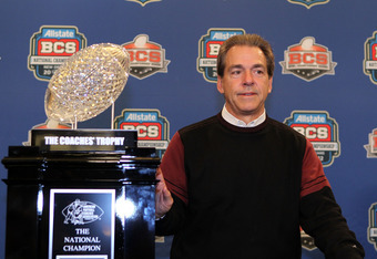NEW ORLEANS, LA - JANUARY 10:  Head coach Nick Saban of the Alabama Crimson Tide stands next to The Coaches' Trophy which signifies the national champion after defeating Louisiana State University Tigers in the 2012 Allstate BCS National Championship Game