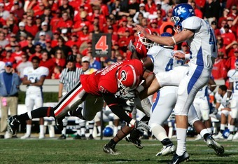 ATHENS, GA - NOVEMBER 17:  Kelin Johnson  #30 of the Georgia Bulldogs blocks a punt by Tim Masthay #44 of the Kentucky Wildcats during the second half at Sanford Stadium on November 17, 2007 in Athens, Georgia.  Georgia defeated Kentucky 24-13.  (Photo by