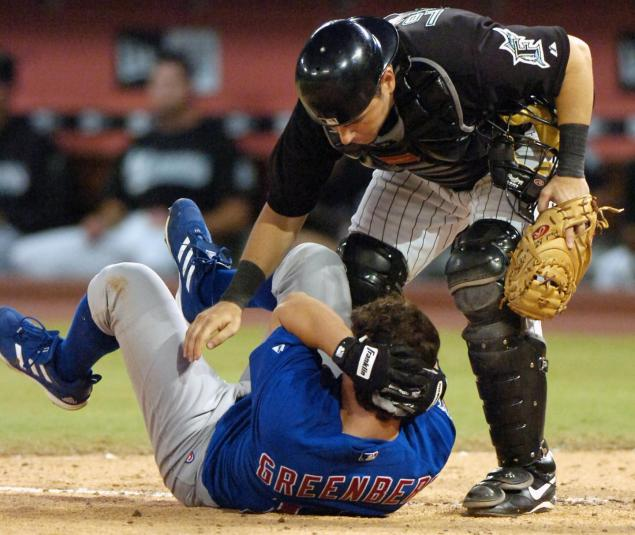 Adam Greenberg drops to the ground after being hit in the back of the head with a fastball.
