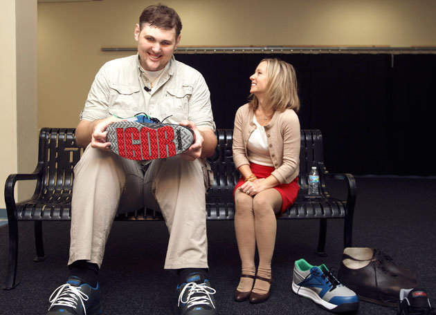 Igot-vovkovinskiy-smiles-as-he-shows-off-his-custom-made-reeboks-to-a-wcco-reporter