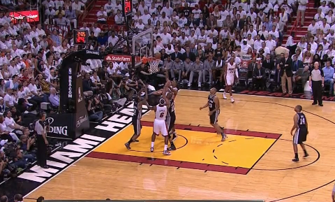 Chris Bosh tips in the LeBron miss for the bucket.