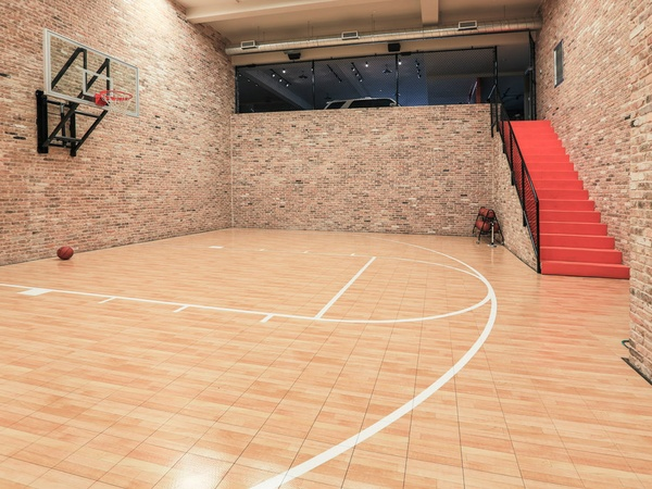 Pro golfer hunter mahan is selling his insane texas for Indoor basketball court installation