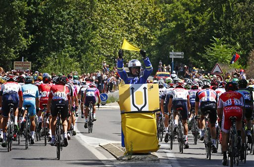 On Bastille Day, storming fans spark chaos at Tour de France
