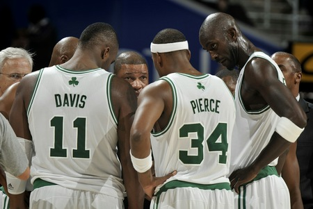 "CLEVELAND - OCTOBER 27:  Head Coach Doc Rivers of the Boston Celtics discusses the next play with Glen Davis #11, Paul Pierce #34 and Kevin Garnett #5 during a break in the action against the Cleveland Cavaliers at The Quicken Loans Arena on October 27, 2010 in Cleveland, Ohio. <br /><br /><span class=""help"">(Photo by David Liam Kyle/NBAE via Getty Images)</span>"