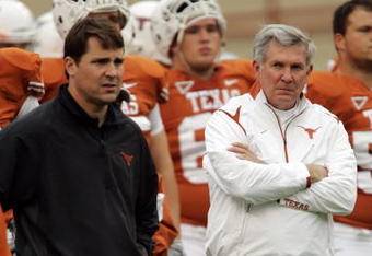 AUSTIN, TX - OCTOBER 10:  Defensive coordinator Will Muschamp and head coach Mack Brown of the Texas Longhorns lead their team in pregame drills before playing the Colorado Buffaloes  on October 10, 2009 at Darrell K Royal-Texas Memorial Stadium in Austin, Texas.  Texas won 38-14.  (Photo by Brian Bahr/Getty Images)