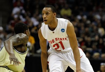 MILWAUKEE - MARCH 21:  Evan Turner #21 of the Ohio State Buckeyes moves the ball while taking on the Georgia Tech Yellow Jackets in the first half during the second round of the 2010 NCAA men's basketball tournament at the Bradley Center on March 21, 2010 in Milwaukee, Wisconsin.  (Photo by Jonathan Daniel/Getty Images)