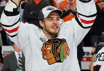 PHILADELPHIA - JUNE 09:  Niklas Hjalmarsson #4 of the Chicago Blackhawks celebrates after teammate Patrick Kane #88 scored the game-winning goal in overtime to defeat the Philadelphia Flyers 4-3 and win the Stanley Cup in Game Six of the 2010 NHL Stanley Cup Final at the Wachovia Center on June 9, 2010 in Philadelphia, Pennsylvania.  (Photo by Jim McIsaac/Getty Images)