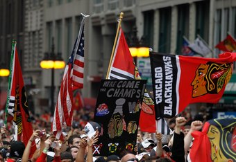 CHICAGO - JUNE 11: Fans on Michigan Avenue cheer during the Chicago Blackhawks Stanley Cup victory parade and rally on June 11, 2010 in Chicago, Illinois. (Photo by Jonathan Daniel/Getty Images)