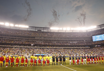EAST RUTHERFORD, NJ - AUGUST 10:  The U.S. and Brazil stand on the field before a friendly match at the New Meadowlands on August 10, 2010 in East Rutherford, New Jersey.  (Photo by Jeff Zelevansky/Getty Images)