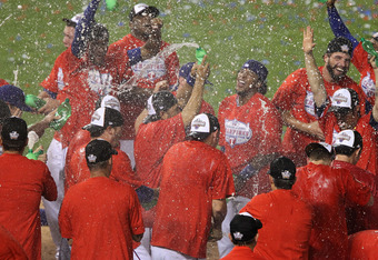 ARLINGTON, TX - OCTOBER 22:  The Texas Rangers celebrate on the field after defeating the New York Yankees 6-1 in Game Six of the ALCS to advance to the World Series during the 2010 MLB Playoffs at Rangers Ballpark in Arlington on October 22, 2010 in Arlington, Texas.  (Photo by Ronald Martinez/Getty Images)