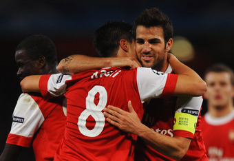 LONDON, ENGLAND - OCTOBER 19:  Samir Nasri of Arsenal (8) celebrates with team mate Cesc Fabregas as he scores their second goal during the UEFA Champions League Group H match between Arsenal and FC Shakhtar Donetsk at the Emirates Stadium on October 19, 2010 in London, England.  (Photo by Laurence Griffiths/Getty Images)