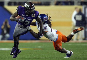GLENDALE, AZ - JANUARY 04:  Antoine Hicks #13 of the TCU Horned Frogs runs after a catch as he is grabbed by Jerrell Gavins #10 of the Boise State Broncos during the Tostitos Fiesta Bowl at the Universtity of Phoenix Stadium on January 4, 2010 in Glendale, Arizona.  (Photo by Jed Jacobsohn/Getty Images)