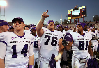 ALBUQUERQUE, NM - NOVEMBER 27: TCU Horned Frogs quarterback Andy Dalton #14, center Jake Kirkpatrick #76 and wide receiver Alonzo Adams #81 celebrate their 66-17 win over the University of New Mexico Lobos on November 27, 2010 at University Stadium in Albuquerque, New Mexico. (Photo by Eric Draper/Getty Images)