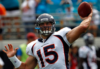 JACKSONVILLE, FL - SEPTEMBER 12:  Quarterback Tim Tebow #15 of the Denver Broncos practices prior to the NFL season opener game against the Jacksonville Jaguars at EverBank Field on September 12, 2010 in Jacksonville, Florida.  (Photo by Sam Greenwood/Getty Images)