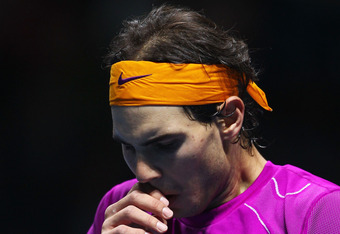 LONDON, ENGLAND - NOVEMBER 28:  Rafael Nadal of Spain looks dejected during his men's final match against Roger Federer of Switzerland during the ATP World Tour Finals at O2 Arena on November 28, 2010 in London, England.  (Photo by Julian Finney/Getty Images)
