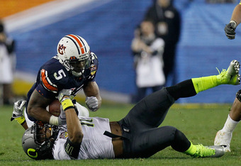 Officials ruled that Michael Dyer's knee did not touch the ground
