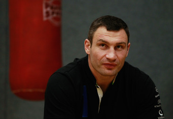 BERLIN - NOVEMBER 16:  Pro boxer Vitali Klitschko sits prior to coaching young boxers at the 'Kick im Boxring' at the TC Gruen Weiss boxing hall in Treptow district on November 16, 2010 in Berlin, Germany. The 'Kick im Boxring' project encourages youth in troubled Berlin city districts to get into boxing. The event was part of the Laureus World Sports Academy Forum.  (Photo by Sean Gallup/Getty Images)